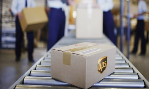 Cape Town, South Africa --- Box on conveyor belt in shipping area --- Image by © Ocean/Corbis