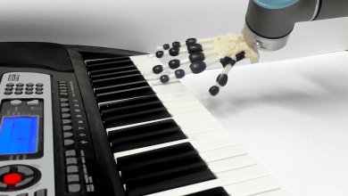 Photo of Piano-playing 3D printed robotic hand spreads holiday cheer