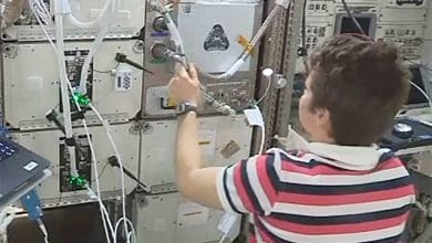 Photo of NASA astronauts install Refabricator 3D printer and plastic recycler aboard ISS