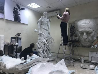 Technician conducting 3D sculpture scanning
