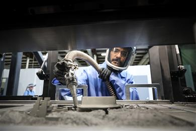 A technician working with binder jet technology