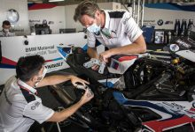 Technicians work on a superbike