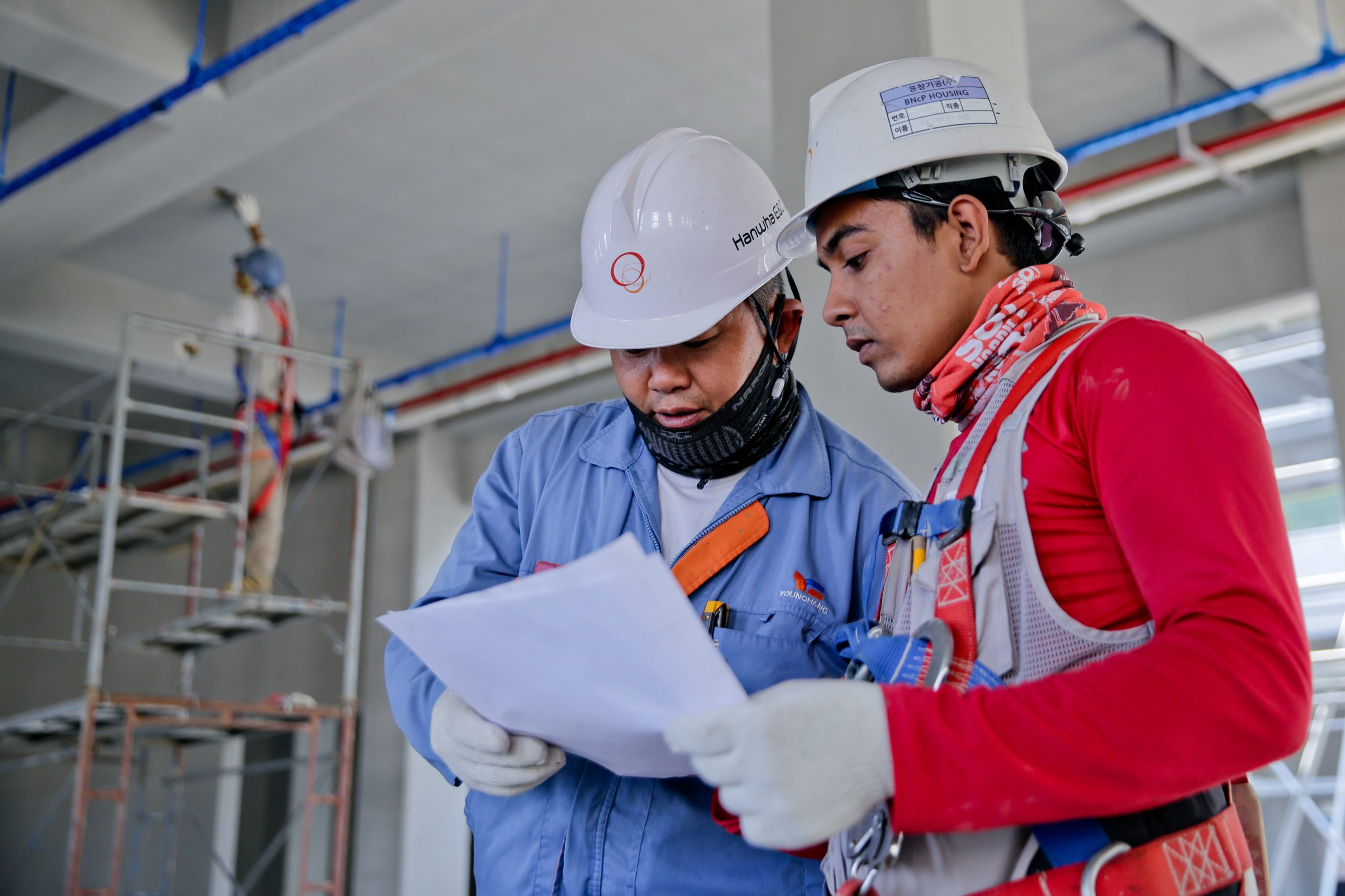 Workers consulting a checklist