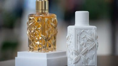 A 3D printed perfume bottle prototype, right, and the finished product from L'Oréal