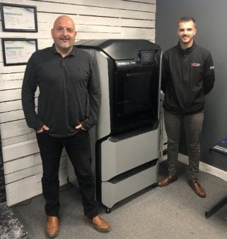 Steve Hardy (left) with son Connor, alongside Prosign's F370 3D Printer, which is already addressing immediate needs and securing new business